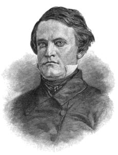 A man with thick, dark hair wearing a high-collared white shirt under a black jacket and tie