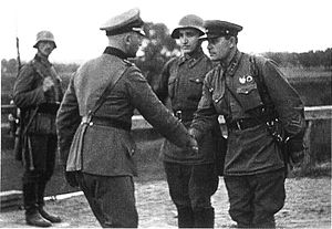 A photo of a German and a Soviet officer shaking hands at the end of the invasion of Poland.