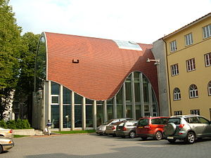 Jewish Synagogue in Tallinn with a red cylindrical rook and glass wall