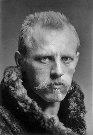 Head and shoulders portrait of Fridtjof Nansen, facing half-right. He has close-cropped hair, a wide, fair moustache and is wearing a heavy fur coat.