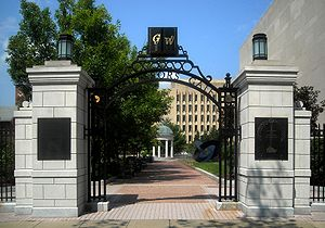 "Open gateway with the letters G and W and the phrase ""Professors Gate"" visible on the arch"