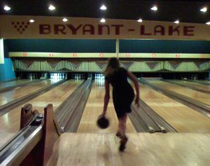 six lanes and a woman bowling solo at Bryant Lake
