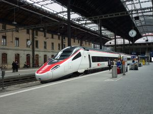 A train awaits departure for Italy.