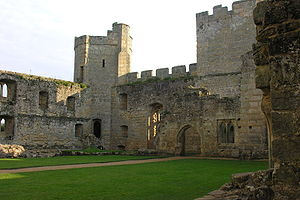 Ruined buildings inside the castle. There is a doorway leading to a ruined room, the kitchen range. In the background is the southeast tower.