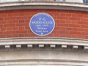 round blue plaque marking Wodehouse's residence, reading: P.G. Wodehouse, 1881–1975: Writer, lived here