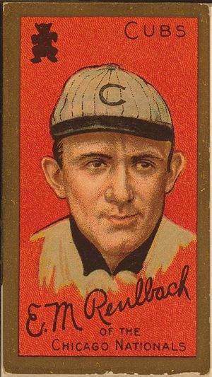 "Baseball card showing a head shot of a man facing forward wearing a white hat with a ""C"" on it.  The card says ""Cubs"" in the upper right corner and says ""Ed Reulbach of the Chicago Nationals"" on the bottom."
