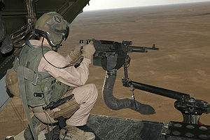 M240 machine gun mounted on V-22 loading ramp with a view of Iraq landscape with the aircraft in flight