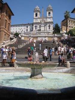 The Spanish Steps, seen from Piazza di Spagna. In foreground, the Fontana della Barcaccia