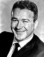 Black and white photo of Red Buttons in 1959.