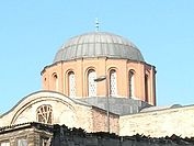 Exterior of a dome at Zeyrek Mosque showing exposed external dome profile and buttressed windows in a drum