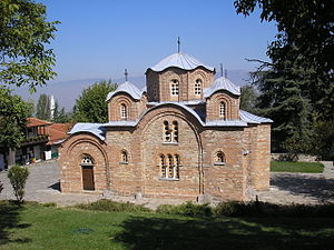 Exterior side view of the relatively small Church of St. Panteleimon showing the central windowed drum and dome as well as two of the four smaller windowed drums and domes built at the corners of the square plan