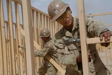 Camp Leatherneck, Afghanistan (13 May 2009) Navy Petty Officers 1st Class John Cid, from Quezon City, Philippines, and Thomas Damron, from Port Hueneme, California, frame walls of the Regimental Combat Team 3 Combat Operations Center at Camp Leatherneck.