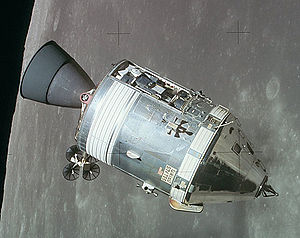 The cone-shaped Command Module, attached to the cylindrical Service Module, orbits the Moon with a panel removed, exposing the Scientific Instrument Module