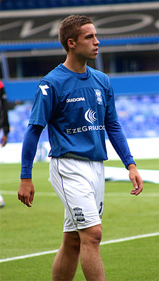 Young man wearing blue and white sports clothing