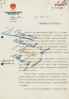 The front page of the Soviet document of decision, with blue writing scrawled across the left-center of the page, authorizing the mass execution of all Polish officers who were as the war prisoners in the Soviet Union