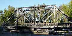 Truss bridge for a single track railway,  converted to pedestrian use and pipeline support