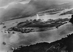 A photograph by an airplane of the Imperial Japanese Navy, facing east over Battleship Row. 7 November 1941.