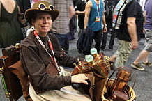 Cosplayer using a steampunk-dressed electric wheelchair during San Diego Comic Con