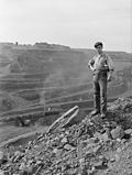 A miner poses near the edge of the pit. The pit is more than three miles long, two miles wide and 535 feet deep.