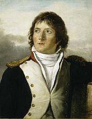 Painting shows a young man with long brown hair. He wears a dark blue military coat with wide white lapels.