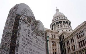 Picture of a large stone monument displaying the ten commandments with the Texas State Capitol in Austin in the background. The picture was part of a news release Wednesday, March second, 2005, by then Attorney General Abbott.