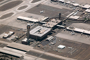 aerial view of Sky Harbor airport, showing the spoke structure of the terminals and gates, with the spike of the control tower toward the lower left of the picture.