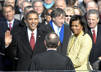With his family by his side, Barack Obama is sworn in as the 44th President of the United States by Chief Justice of the United States John G. Roberts, Jr.
