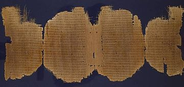 A four-page papyrus manuscript, which is torn in many places