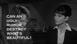 "Still shot of a film trailer showing Shirley MacLaine looking down at the left and Audrey Hepburn to her right staring at her, in a bedroom. The words ""Can an ugly rumor destroy what's beautiful?"" obscure much of MacLaine's face"