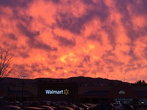 Sunset over Plymouth Walmart location. Windmills atop Tenney Mountain visible in the background.