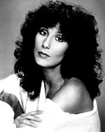 Black-and-white publicity photo of Cher circa the 1970s.