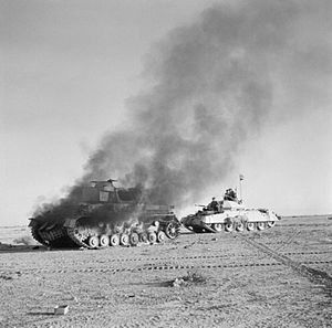 "Crusader tank passing burning Panzer IV tank during Operation ""Crusader"""