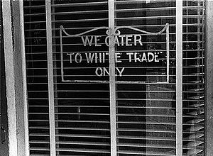 "A sign reading ""We Cater to White Trade Only"""