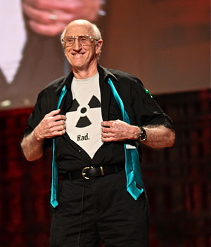 "Stewart Brand wearing a shirt bearing the radioactive trefoil symbol with the caption ""Rad."""