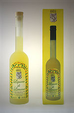 A yellow liquor bottle next to the yellow packaging it is sold in