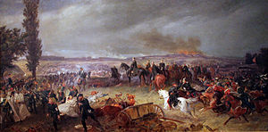 An oil painting of a battlefield, with several mounted cavalry in black; an indistinct city burning on the horizon.