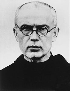 Priest wearing round-rimmed glasses
