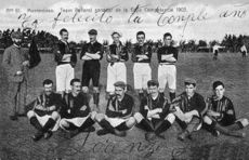 Old team photo, with half the players sitting and half standing