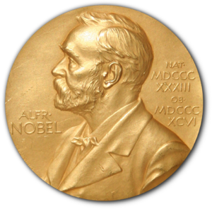"A golden medallion with an embossed image of a bearded man facing left in profile. To the left of the man is the text ""ALFR•"" then ""NOBEL"", and on the right, the text (smaller) ""NAT•"" then ""MDCCCXXXIII"" above, followed by (smaller) ""OB•"" then ""MDCCCXCVI"" below."
