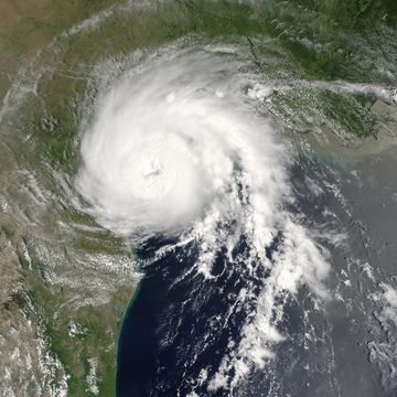 View of the storm from Space on July 13, 2003. The roughly circular storm is about to make landfall in Texas. Mexico and Louisiana are seen to the south and north, respectively.