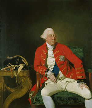 Three-quarter length seated portrait of a clean-shaven George with a fleshy face and white eyebrows wearing a powdered wig.