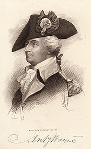 Print shows a man wearing a dark military coat with light lapels and epaulettes. He also wears a large tricorne hat.