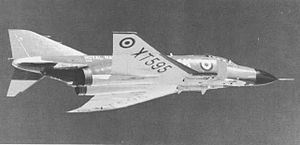Starboard black-and-white view of jet aircraft in-flight.