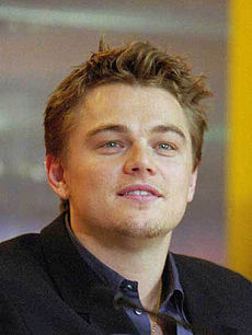 A photograph of Leonardo DiCaprio attending a press conference for The Beach.