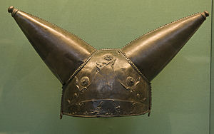 bronze helmet with two conical horns