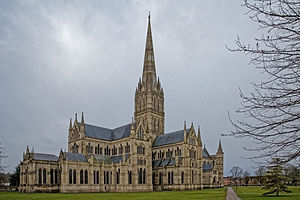 Salisbury Cathedral from the East showing features of the North Facade and grey masonry spire. The exterior shows the same harmony in the groupings of simple windows that is apparent in the interior view.