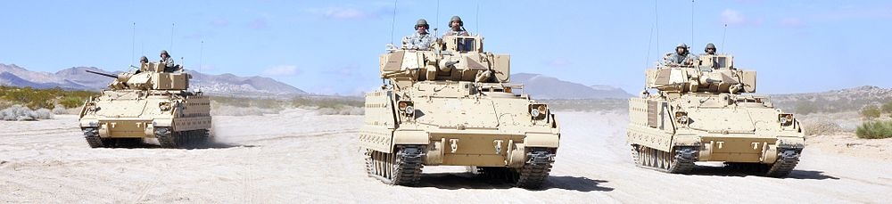 "Soldiers of the 1st Battalion, 185th Armor (Combined Arms Battalion) maneuver in a ""wedge formation"" in Bradley Fighting Vehicles at Fort Irwin National Training Center, 2011"