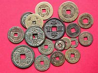 Numerous coins with square holes and with Chinese characters inscribed