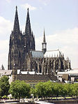 A large gothic style cathedral of grey to black colored stone.
