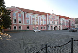 Toompea Castle pink stucco three story building with red hip roof